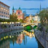 Romantic medieval Ljubljana, Slovenia, Europe. Romantic Ljubljana city center. River Ljubljanica, Triple Bridge - Tromostovje, Preseren square and Franciscan Royalty Free Stock Image