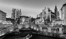 Romantic medieval town of Ljubljana, Slovenia, Europe. Romantic Ljubljana`s city center in black and white: river Ljubljanica, Triple Bridge - Tromostovje Stock Photo