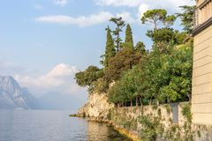 Romantic mediterranean landscape in Malcesine on Lake Garda. With cypresses and mountains royalty free stock photo