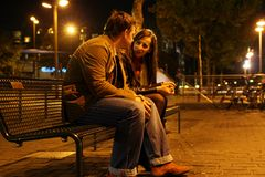 Romantic Meeting. A couples during a romantic meeting in the night city Stock Photo