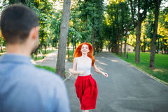Romantic meeting, couple in green summer park Royalty Free Stock Photography