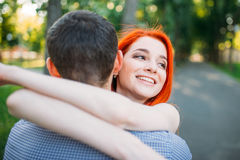 Romantic meeting, young couple hugs together Royalty Free Stock Photos