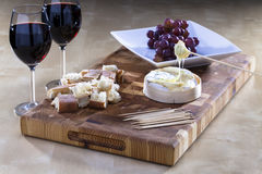 Romantic Melted camembert. Cheese with bread served on a plate Stock Photo