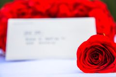 A rose and a romantic note Royalty Free Stock Image