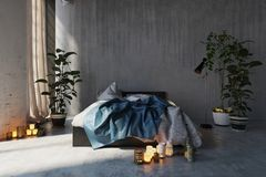 Romantic Messy Bedroom Interior With An Unmade Bed And Glowing Candles On The Floor In