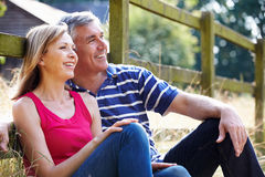 Romantic Middle Aged Couple Relaxing On Walk In Countryside Stock Images