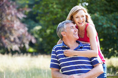 Romantic Middle Aged Couple Walking In Countryside royalty free stock photography