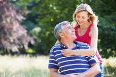 Romantic Middle Aged Couple Walking In Countryside Stock Images