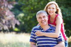 Romantic Middle Aged Couple Walking In Countryside royalty free stock image