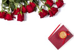 Romantic mockup. Beautiful bunch of large red roses, book, color pencils and small cup of coffee on white background. Stock Photography