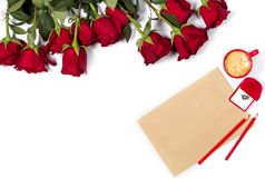Romantic mockup. Beautiful bunch of large red roses, sheet of craft paper, color pencils, small cup of coffee and box with ring Stock Image