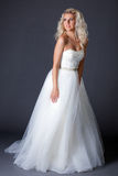 Romantic model posing in fashionable wedding dress Royalty Free Stock Images