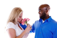 Romantic Moment. A man caresses a woman after givng her flowers royalty free stock photos