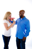 Romantic Moment. A man caresses a woman after givng her flowers stock photos
