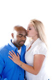 Romantic Moment. A woman kisses a man's forehead royalty free stock images