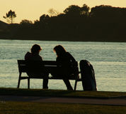 Romantic moment. Couple dating at riverside at sundown Royalty Free Stock Image