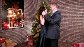 Romantic moment for a husband and wife, loving couple dancing at a party, man hugging woman, New Year`s party near the stock video