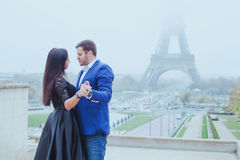 Romantic moment near Eiffel tower. Portrait of couple in love Stock Photo