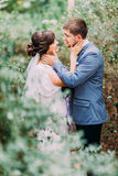 Romantic moment of newly married couple in green summer park Royalty Free Stock Photography