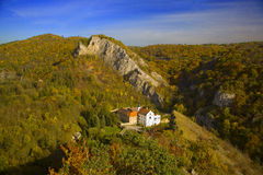 Romantic monastery near Prague. A famous monastery Svaty Jan pod Skalou about 20 km from Prague, Czech republic, in autumn/fall colors royalty free stock photography