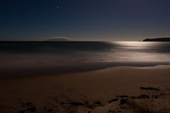 Romantic moonlight ocesn sand beach, long exposure stock photo