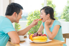 Romantic morning. Image of a cheerful couple having breakfast at home Royalty Free Stock Image