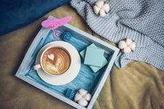 Romantic morning on Valentine`s Day - breakfast in bed on a wooden turquoise tray are a cup of coffee, top view stock photo