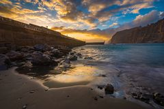 Spectacular sunset over the ocean, romantic, multi-colored sunset in Tenerife, Los Gigantes cliffs. Romantic, multi-colored sunset in Tenerife, Los Gigantes Royalty Free Stock Image