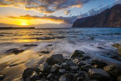 Spectacular sunset over the ocean, romantic, multi-colored sunset in Tenerife, Los Gigantes cliffs. Romantic, multi-colored sunset in Tenerife, Los Gigantes Stock Photography