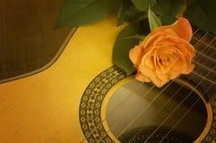 Romantic music. Classical spanish guitar with orange rose royalty free stock photo