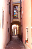 Romantic narrow alley in Noli,Italian Riviera. The Italian village of Noli, situated on the Western part of the Ligurian Riviera, is a traditionally important Stock Images