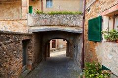 Romantic narrow street and balcony in Montepulciano, Tuscany, Italy. Stock Photos