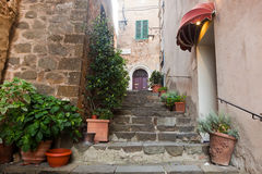 Romantic narrow street and stairs in Montepulciano, Tuscany, Italy. stock photos