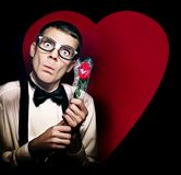 Romantic Nerd With Rose On Love Heart Background Royalty Free Stock Photography