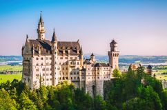 Romantic Neuschwanstein castle in the morning at summertime.  royalty free stock photos