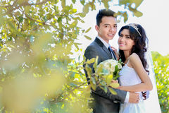 Romantic newlywed couple happy being together. Portrait of romantic newlywed couple happy being together with copy space Stock Image