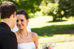 Romantic newlywed couple looking at each other in park Royalty Free Stock Image