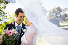 Romantic newlywed looking at each other in park Stock Photography