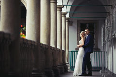 Romantic newlywed valentine couple hugging on antique balcony wi Royalty Free Stock Photos