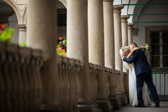 Romantic newlywed valentine couple kissing on antique balcony wi Stock Images