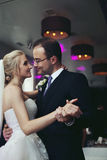 Romantic newlyweds, bride and groom first dance, holding hands, Royalty Free Stock Images