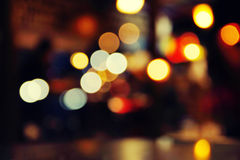 Romantic night in a cafe. Romantic lights illumination in a cafe, abstract blurred background stock images