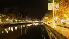 Romantic night promenade along waterfront of Nervion river in Bilbao, time-lapse stock video