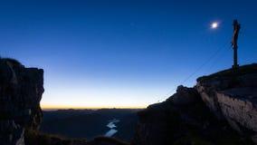 Romantic night scene with mountain cross Stock Photo