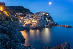 Romantic night view of colorful village Manarola in Cinque Terre National Park, Italy Stock Photography