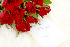 Romantic note with red roses Stock Image