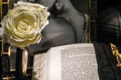 Romantic Novel. Still-Life Romantic Scene with Open Book and Black & White Photograph Stock Photo
