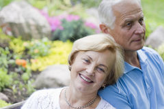 Romantic old couple sitting together Stock Images