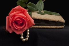 Romantic old diary with rose and pearl royalty free stock image