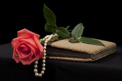 Romantic old diary with rose and pearl stock photos